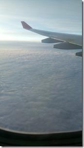 И вот мы уже летим над облаками